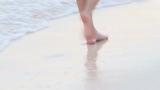 View of Womans Legs Walking Down Bermuda Beach