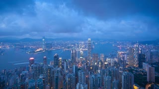 View over Hong Kong from Victoria Peak, the illuminated skyline of Central sits below Victoria Peak, Hong Kong, China, T/lapse