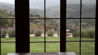 View Through Window To Green Valley Below