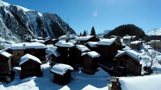 village covered with snow. snowcapped. winter tourism