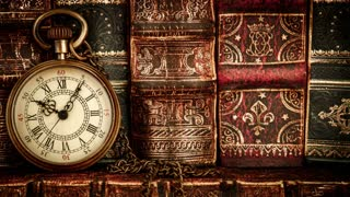 Vintage antique pocket watch against the background of old books