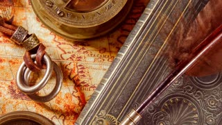 Vintage book, compass, telescope and a pocket watch lying on ancient world map in 1565.