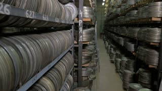 Vintage reel, video or audio tapes in a old media archives shelfs