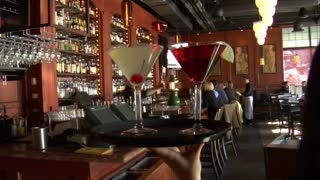 Waitress Carries Martinis On Trays Through Bar