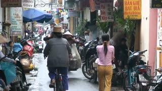 Walking Along Rainy Street In Vietnam