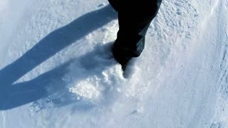 walking in snow. feet foot steeps. winter sports. recreation activity. hiking