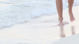 Walking Through Water and Sand on Bermuda Beach