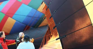 Watch as a crew fills a hot air balloon with air