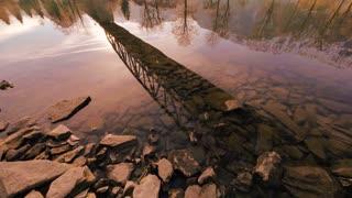 water reflection. bridge lake panorama view. sunset mood