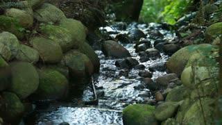 Water running through dark and light rocks