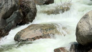 Water Rushing Over Round Stone