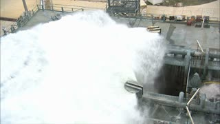 Water Sound Suppression System Flooding Gallons on Launcher