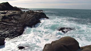 Waves Crashing On Rocks On Shore