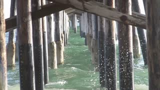Waves under the dock