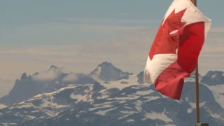 Waving Flag By Snowy Mountains