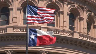 Waving Texas and American Flags on Capitol