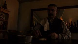 Western Bartender Cutting Lemons