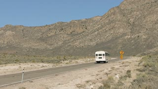 White Bus Driving Down Highway 375 Towards Alamo Nevada