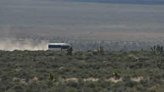 White Bus Traveling on Groom Lake Road Near Area 51