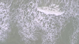 White caps on sea waves, aerial view from above. Slow motion video