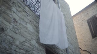 White Cloth Hanging On The Facade Of The Building