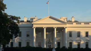 White House With Flag Waving on Top