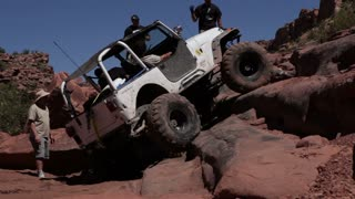 White jeep caught on rocks 1
