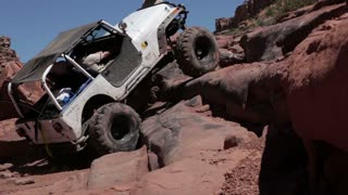 White jeep caught on rocks 3