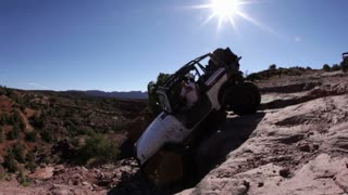 White Jeep Plunging Over Steep Ledge
