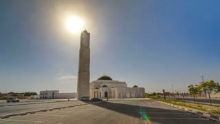 White mosque in Ajman timelapse hyperlapse with sun, United Arab Emirates