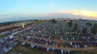 wide angle aerial over packed stadium parking lot