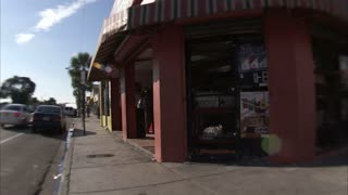 Wide Angle Lens View of Passing Shops in Miami
