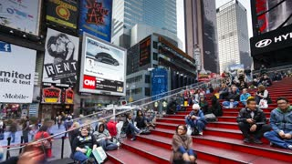 Wide angle view of people enjoying the neon lights of 42nd Street, Times Square, Manhattan, New York City, New York, United States of America, North America, Time-lapse