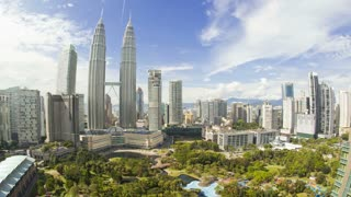 Wide angled elevated cloudscape view of the Petronas Twin Towers, Kuala Lumpur City Centre KLCC, Malaysia, Kuala Lumpur, Asia, Time lapse