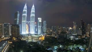Wide angled illuminated nighttime view of the Petronas Twin Towers, Kuala Lumpur City Centre KLCC, Malaysia, Kuala Lumpur, Asia, Time lapse