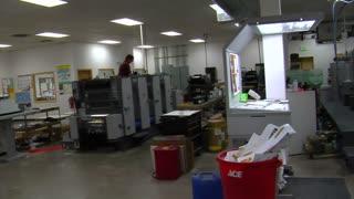 Wide Panning Shot Of Print Shop