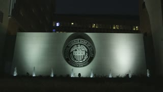 Wide Shot Federal Reserve Bank of Dallas Seal at Night