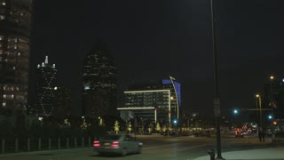 Wide Shot of Dallas Buildings at Night with Traffic