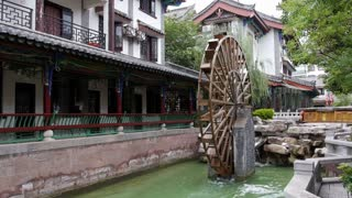 Wide Shot of Old Chinese Water Wheel