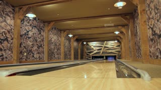 Wide shot of private bowling alley.