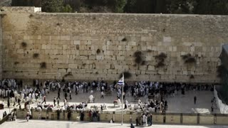 Wide Shot Of Worshippers At Wall