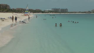 Wide View of Island Beach with People Swimming 2