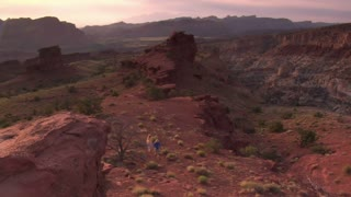 Wide Vista As Couple Hikes Across Landscape Capitol Reef National Park