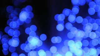 Wiggling Spots of Blue Light