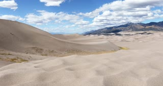 Wind blowing sand on sunny day in Great Sand Dunes National Park