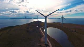 Windmills for electric power production. Arctic View Havoygavelen windmill park, Havoysund, Northern Norway Aerial footage.