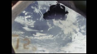Window View of Lunar Module in Space