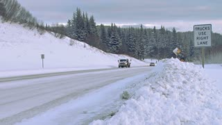 Winter Road Traffic on Snowy Highway Downhill