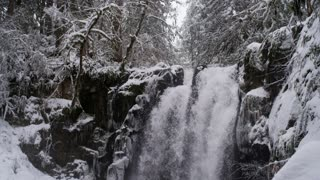 winter wonderland with cascading waterfall
