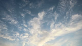 Wispy Clouds Dance Through Blue Sky Time Lapse